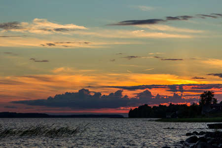 Beautiful tranquil summer sunset on the Onega lake, Karelia, Russia