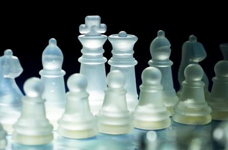 the light illuminate the chess set from behind photo