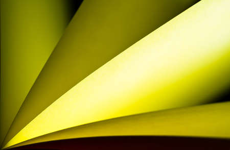 arise: Yellow notepad paper illuminated by LED viewed in landscape arise from left lower