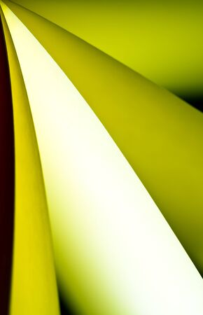 arise: yellow notepad paper illuminated by LED viewed in portrait arise from top-left Stock Photo