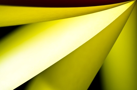 Yellow notepad paper illuminated by LED viewed in landscape arise from upper right Stock Photo - 9553743