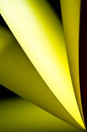Yellow notepad paper illuminated by LED viewed in portrait arise from bottom down photo