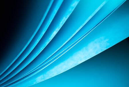 Blue notepad paper illuminated by LED viewed in landscape arise from lower left Stock Photo