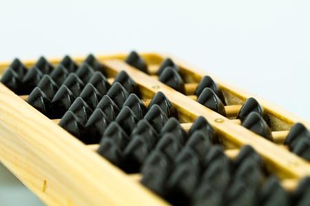 abacus on white bluish background photo