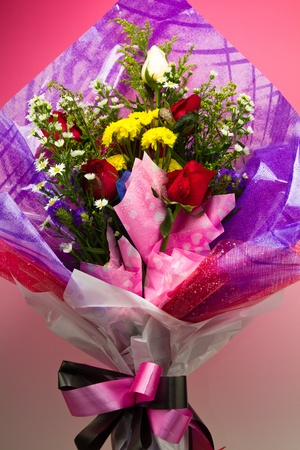 a graduation bouquet of various flowers for her photo