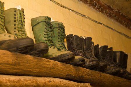 world war II military boots on wooden display shelf