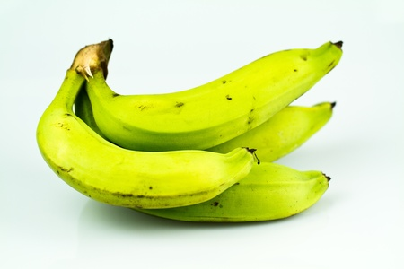green banana bunch isolated on white bluish background