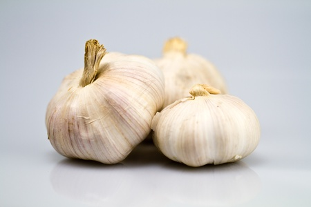 Three garlic bulbs isolated  photo