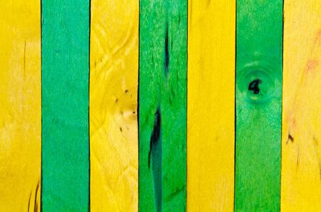 vertical arrangement of green and yellow wood in landscape orientation photo