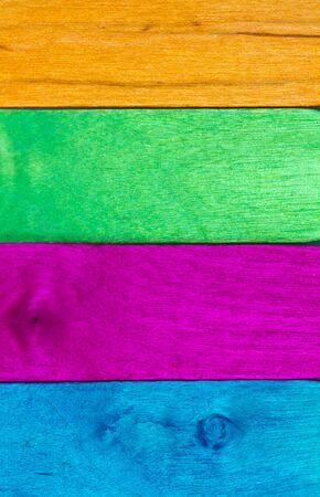 horizontal arrangement of multicolor wood in portrait orientation photo