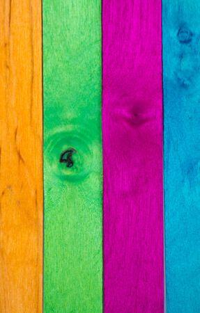 Vertical arrangement of multicolor wood in portrait orientation photo