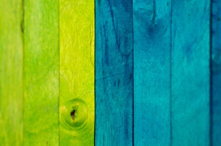 Vertical arrangement of green and blue wood in landscape orientation photo
