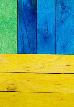 Colorful pine wood arrangements with green yellow and blue plank photo