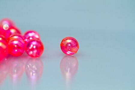 red beads on bluish background