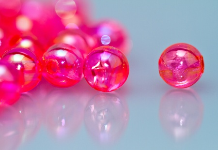 close up of red beads on bluish background photo