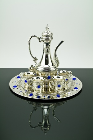 Silver set on a mirror photo