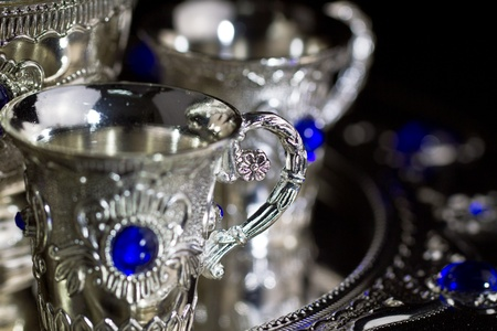Silver set cup close up with dark background photo