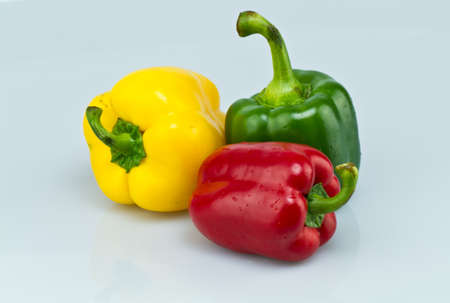 Yellow, green and red capsicums  Stock Photo - 11496177
