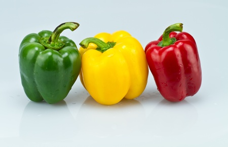 three capsicums on bluish surface II Stock Photo - 11496176