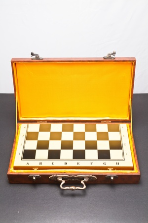 Checker board in  leather box wit yellow lining photo