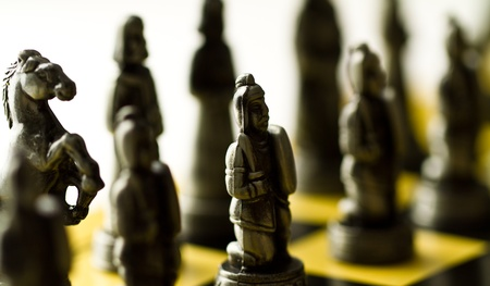Silver chess set backlit on the checker board with bright background Stock Photo - 11826977