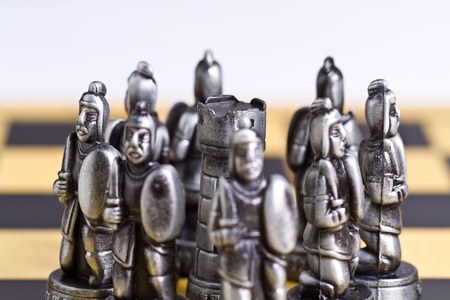 Rook peice surrounded by pawn pieces with bright background