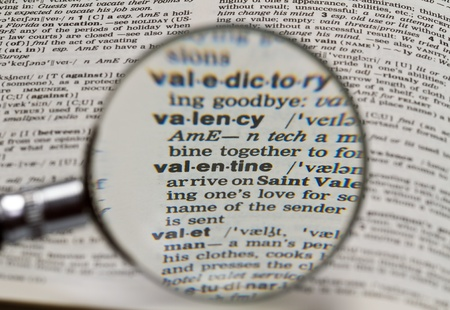 vaentine word in dictionary magnified by hand held magnifying glass photo
