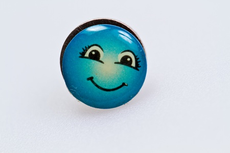 smiley character on metal thumbtack on white surface Stock Photo - 11827214