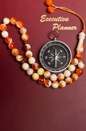 executive planner with rosary beads in portrait orientation photo