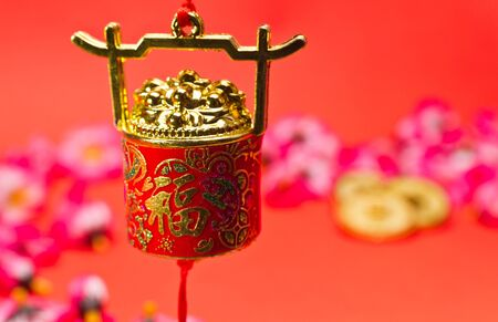 Chinese New Year ornament on red background with blurry image for festive using photo