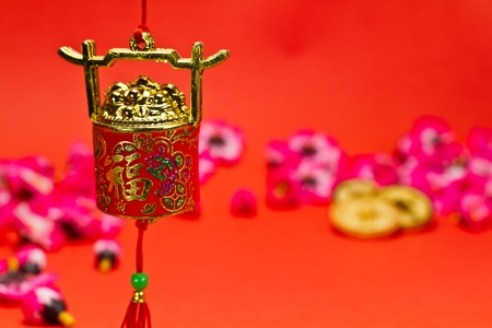 Chinese New Year ornament on red background with cherry blossom for festive using photo