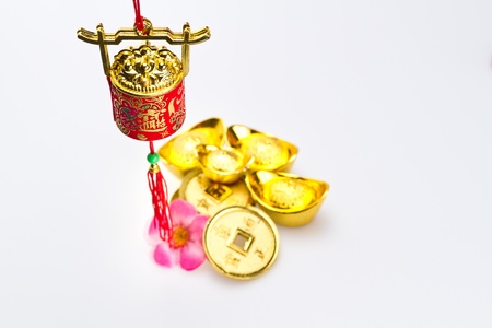 fa: Hanging red wealth pot with gold igots and coins on white surface