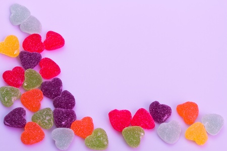 Love-shaped jelly on white background under purple gel illumination for background use