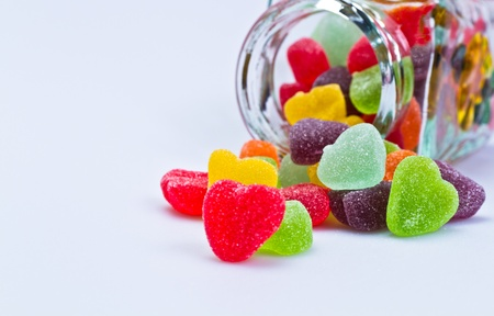 close up view of love-shaped jelly spilled from a glass container Stock Photo