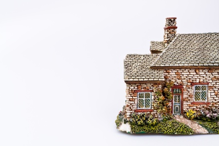 Replica of a country house on White Background with copy space photo