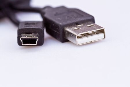 Dusty used USB plug on white background