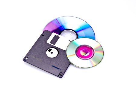 data storing item such as dvd and disket on white background photo
