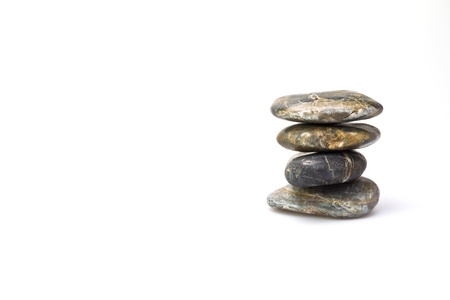 Balancing stones on white background right hand margin landscape orientation