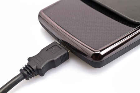 close up view of a portable harddisk in  soft leather case and USB cable on white background Stock Photo - 12307144