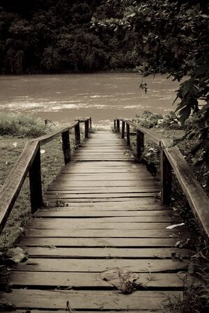 Old wooden bridge in old style photo in portrait orientation photo