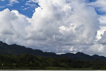 view of highlands from Rajang River in Sarawak, Malaysia with clouds forming in the background Stock Photo - 12638202