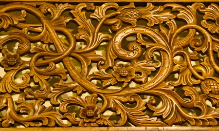 Detail of a wood panel decoration with carved flower
