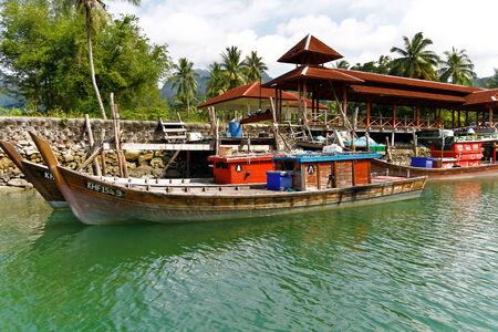 trawl: Colorful Fishing Trawler at anchor Editorial