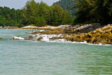 Wave splashing onto wave breaker photo