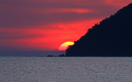 Sun set behind island in Langkawi, Malaysia Stock Photo