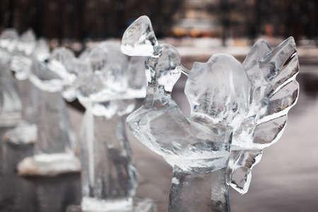 sculpt: Icy sculpture of frozen angel in winter city