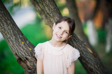 Portrait of nice little girl outdoors on warm and sunny spring day 写真素材