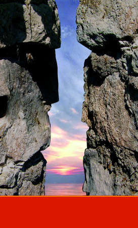 paganism: the heads from a stone in a profile against the evening sunset sky