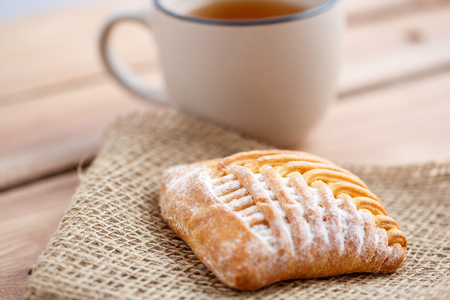 tea with cottage cheese cookies on wooden rustic background.