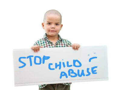 boy holding a sign stop child abuse in the hands. In light background. Stockfoto
